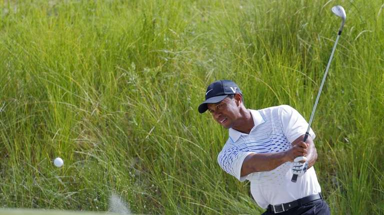 Tiger Woods chips to the seventh green during