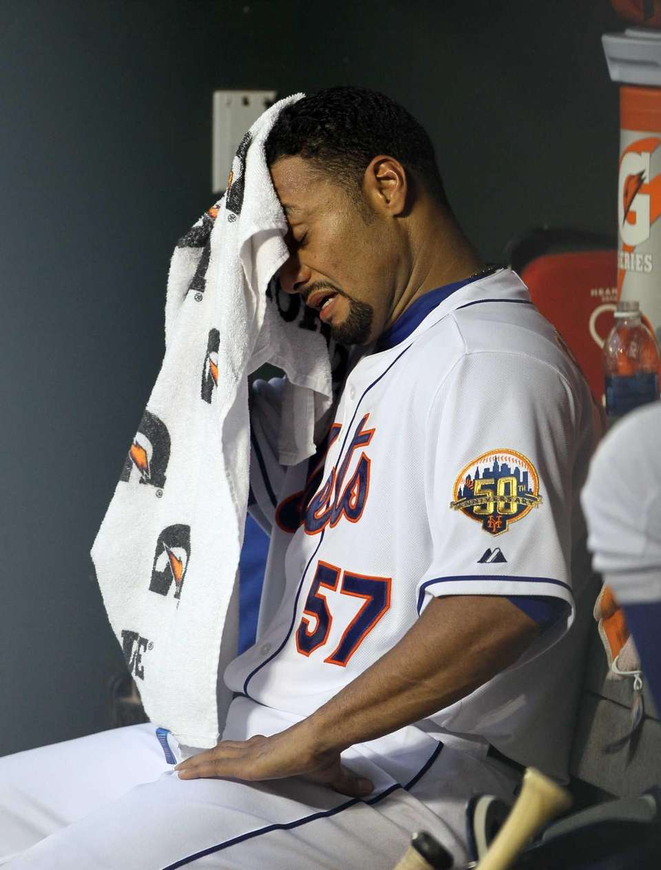 Johan Santana sits in the dugout after leaving