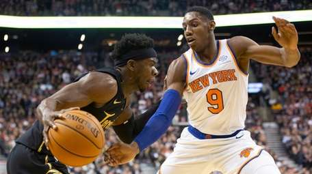 Toronto Raptors' Terence Davis (left) drives at Knicks'