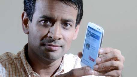 Mahmud Wazihullah shows the smartphone version of the