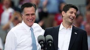Mitt Romney jokes with Paul Ryan (R-WI) (R)