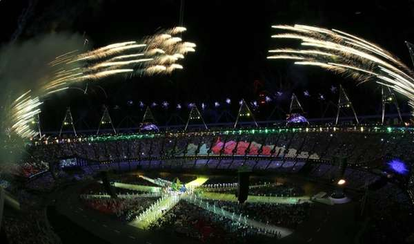 Fireworks soar over the Olympic Stadium during the