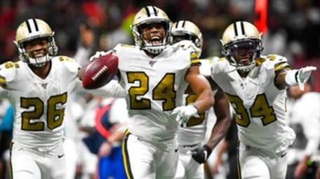 Saints strong safety Vonn Bell celebrates with teammates