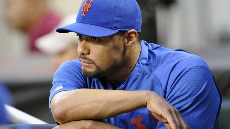 Johan Santana watches from the dugout in the