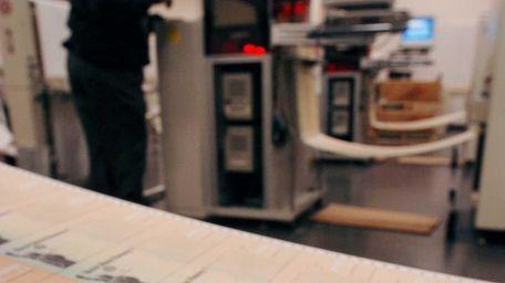 Rolls of blank social security checks run through