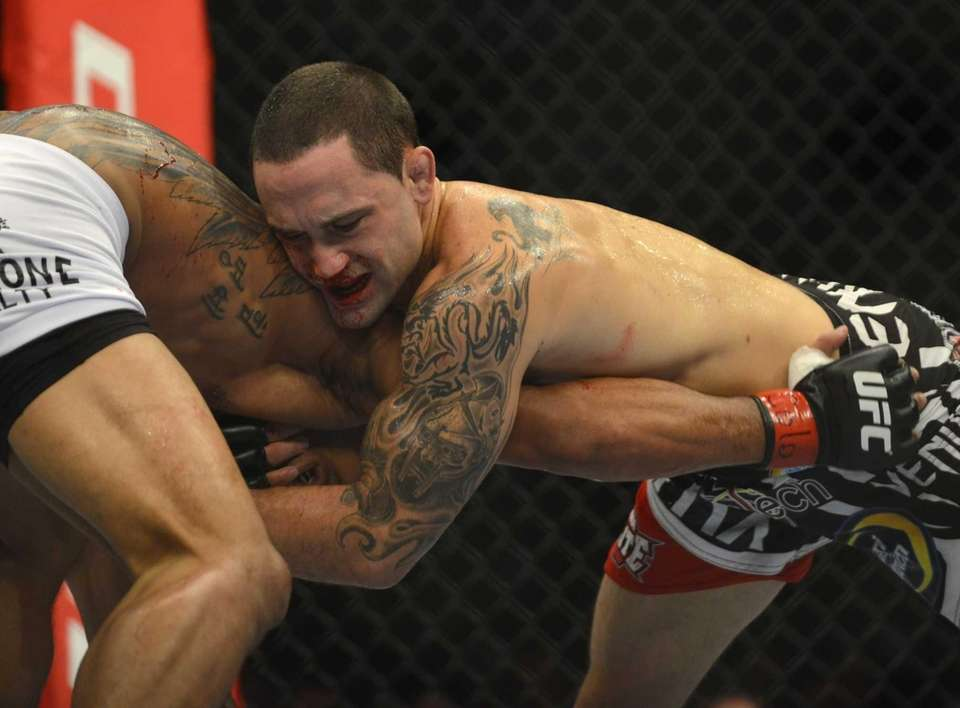 A bloodied Frankie Edgar from New Jersey fights