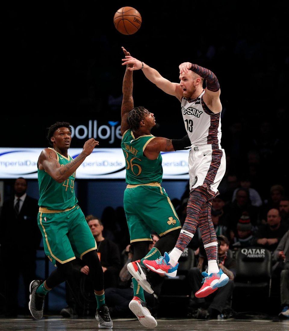 Dzanan Musa #13 of the Brooklyn Nets passes