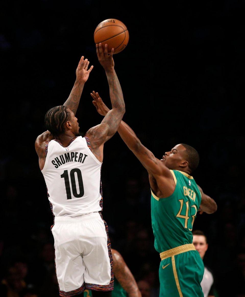 Iman Shumpert #10 of the Brooklyn Nets puts