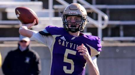 Sayville quarterback Jack Cheshire looks to throw against