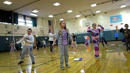 Children practice jumping rope in Kathy Mundy's gym