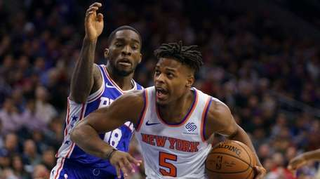 Dennis Smith Jr., right, shown here against the