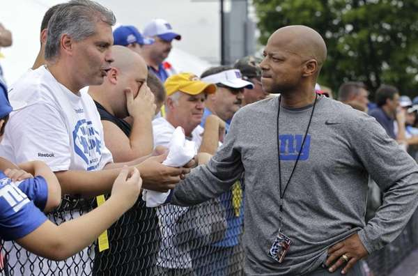 New York Giants general manager Jerry Reese, right,