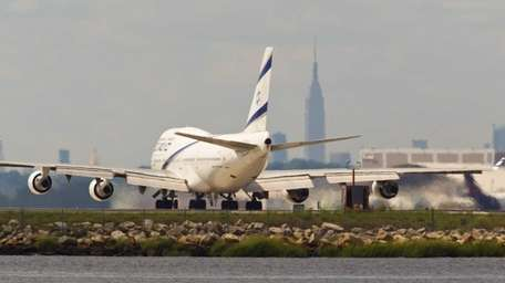Aircraft land and take off at Kennedy Airport.