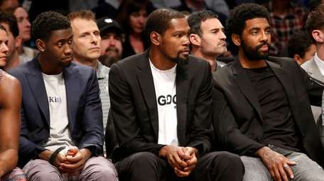 From left, Caris LeVert, Kevin Durant and Kyrie