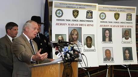 Suffolk County District Attorney Thomas Spota holds a