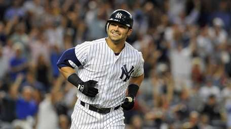 Nick Swisher smiles into the Yankees dugout after