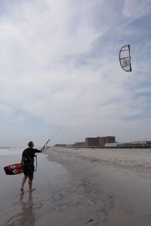 Kiteboarder Joe Decunzo tries to catch enough wind