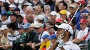 Defending US Open champion Tiger Woods watches his