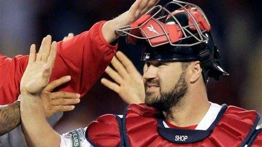 Boston Red Sox catcher Kelly Shoppach celebrates with
