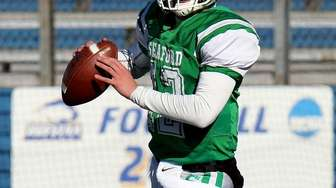 Seaford QB Logan Masters rolls out of the