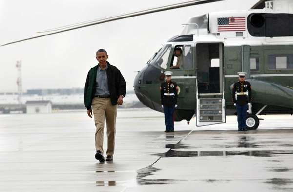 US President Barack Obama walks across the tarmac