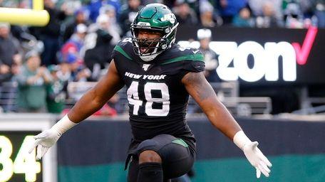 Jordan Jenkins #48 of the Jets celebrates a