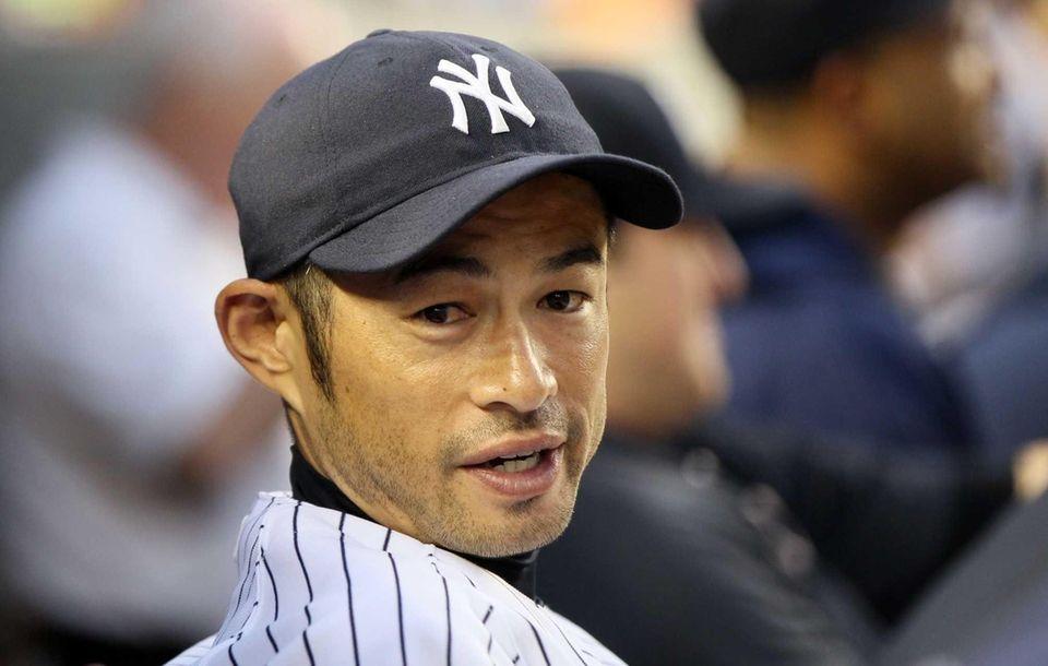 Ichiro Suzuki looks on from the dugout during
