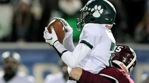 Lindenhurst DB Matthew Newman makes the interception with