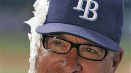 Rays manager Joe Maddon smiles after taking a