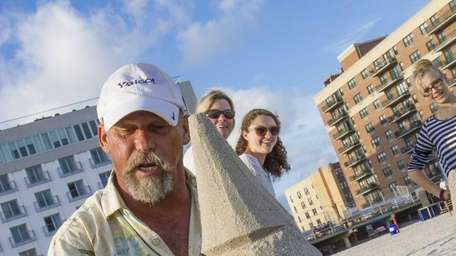 Sand artist Andrew Gertler instructs a class in