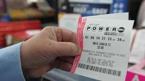Lorraine Trotta, of Lindenhurst, buys the new Powerball