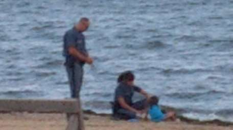 New York State Park Police officers accompany a