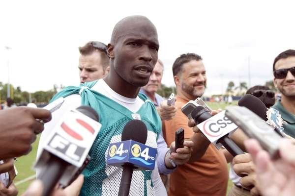 Miami Dolphins player Chad Ochocinco talks to the