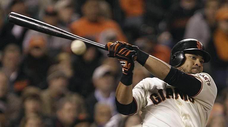 San Francisco's Melky Cabrera fouls off a pitch