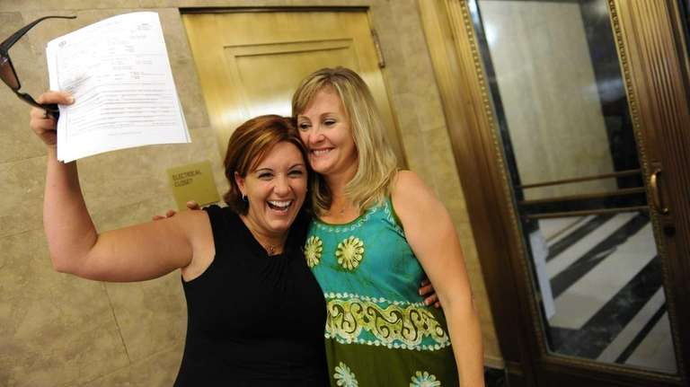 Kimberly Moreno, left,and Wendy Torrington show off their