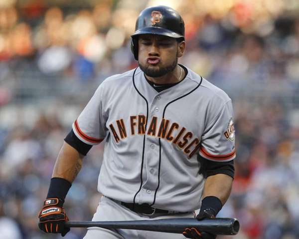 San Francisco Giants outfielder Melky Cabrera reacts after