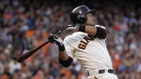 San Francisco Giants' Melky Cabrera hits an RBI