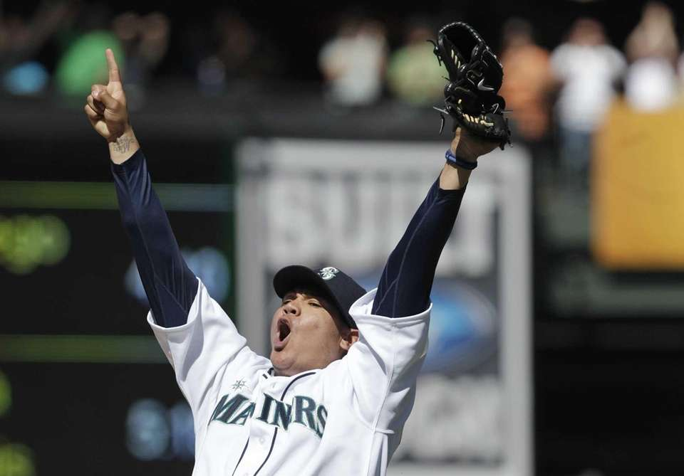 Seattle Mariners pitcher Felix Hernandez celebrates after throwing