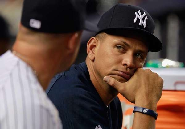 Alex Rodriguez looks on from the bench during