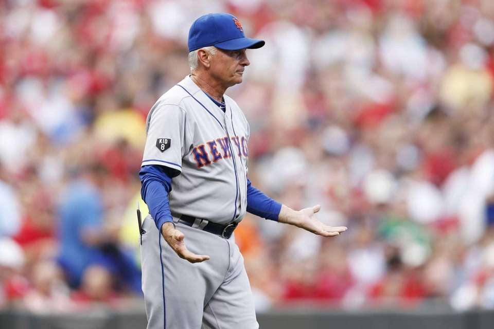 Mets manager Terry Collins questions umpires during a