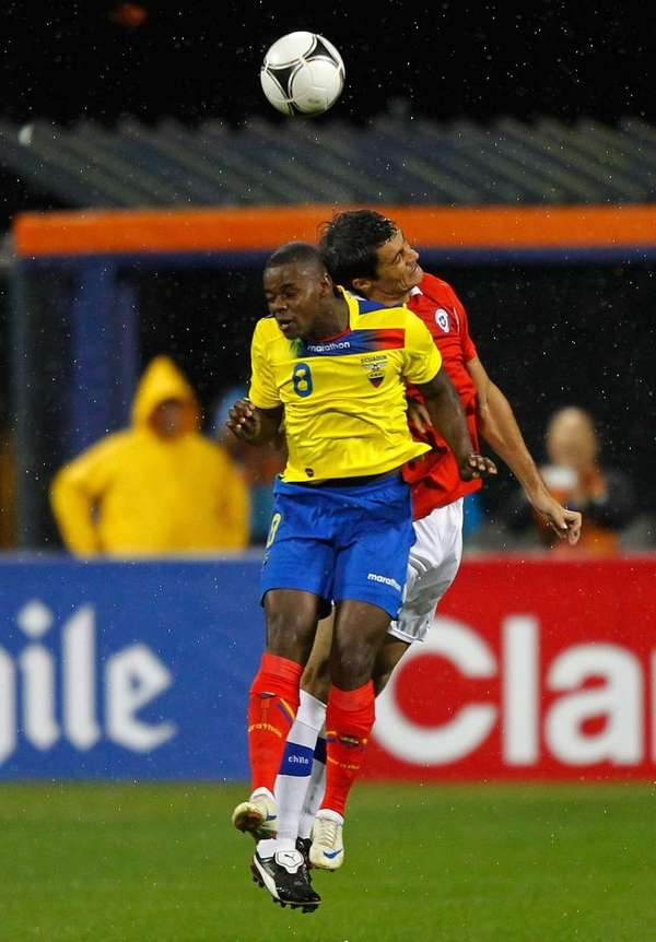 Narcisco Mina #8 of Ecuador heads the ball