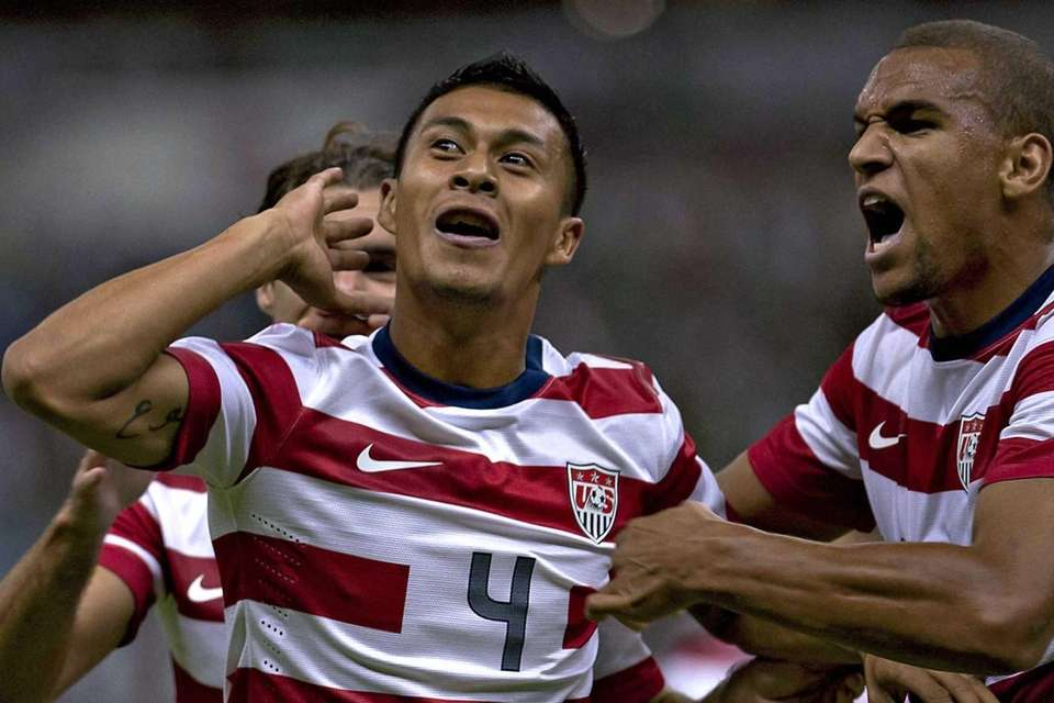 Michael Orozco celebrates a goal against Mexico during