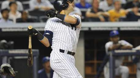 Nick Swisher doubles during the third inning to