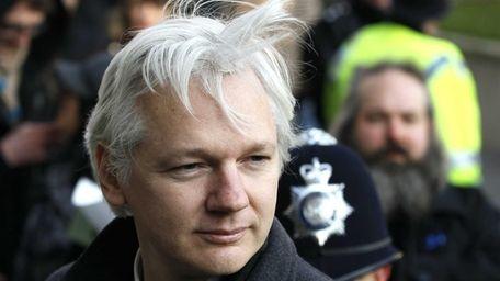 Julian Assange arrives at the Supreme Court in