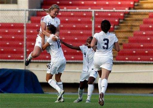 Lindsey Horan, left, celebrate her goal against Mexico