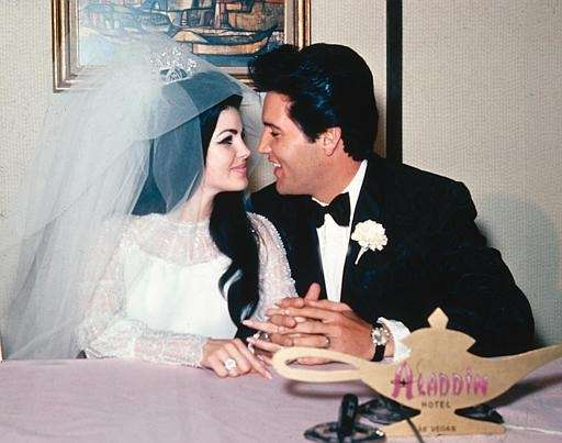 Singer Elvis Presley and his bride, the former