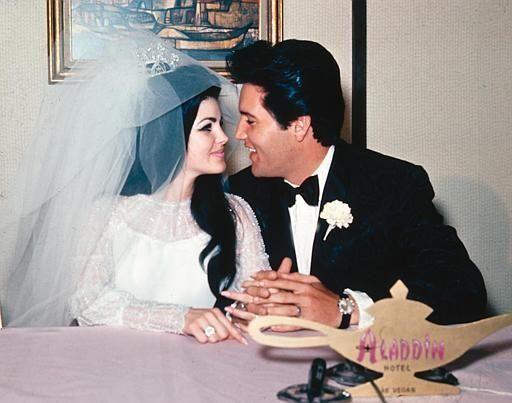 Singer Elvis Presley and his bride, the former