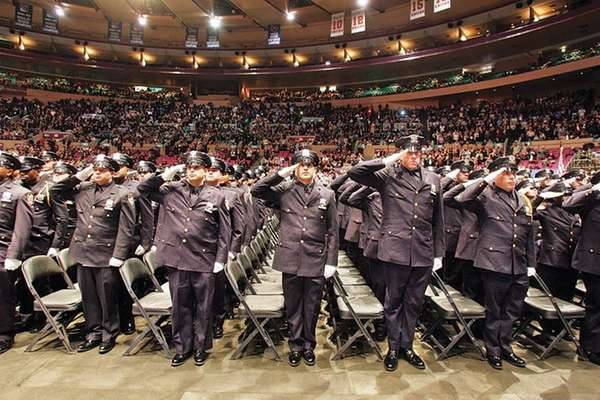 New York City Police Academy graduates salute on