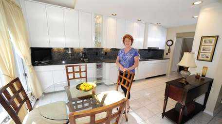 Susan Kelly in the kitchen of the house