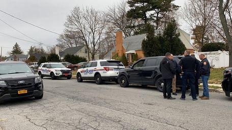 Nassau Police investigate the scene of a break-in